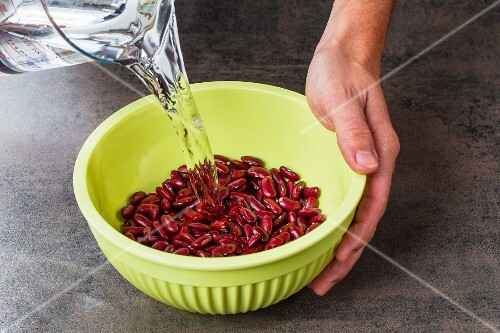 Kidney beans being soaked in water