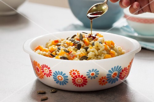Vegan pumpkin risotto with fresh oranges and pumpkin seed oil