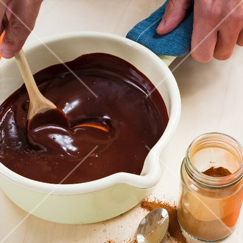 Chocolate sauce being made from vegan chocolate and coconut milk