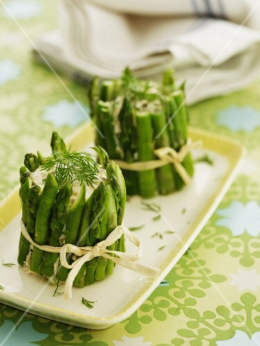 Fish salad wrapped in asparagus