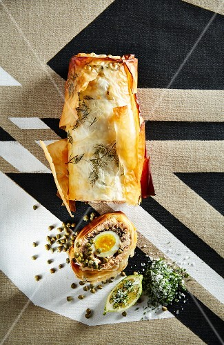 Salmon strudel with mushrooms, egg and capers