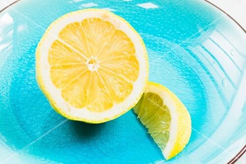 Half a lemon and a lemon wedge