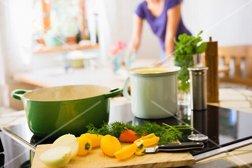 A kitchen scene featuring vegetables