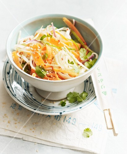 Vegan oriental rice noodle salad with carrots and ginger