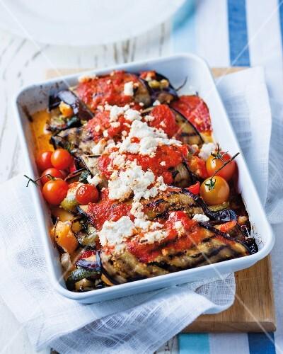 Aubergine rolls filled with ricotta, tomato sauce