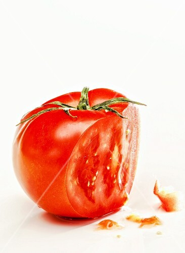 A tomato, sliced