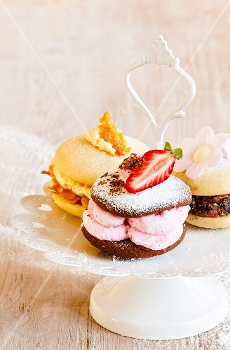 Various whoopie pies on a cake stand