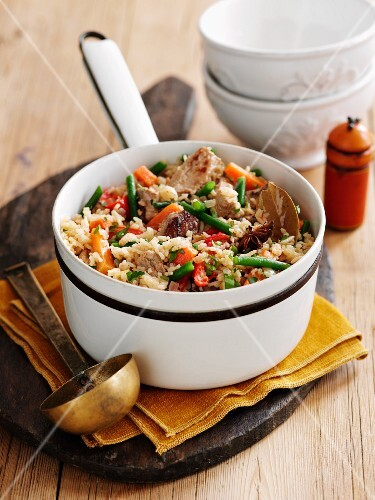 Rice stew with pork, vegetables and spices