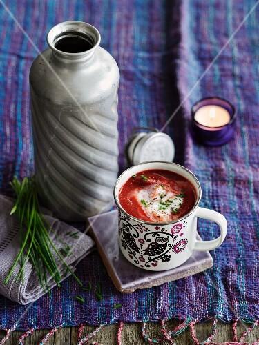 Borscht (beetroot soup, Eastern Europe) in an enamel mug