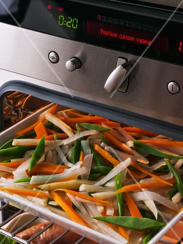 Steamed vegetables in an oven