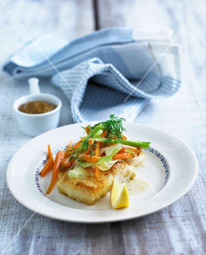 Breaded fish fillet with a carrot salad