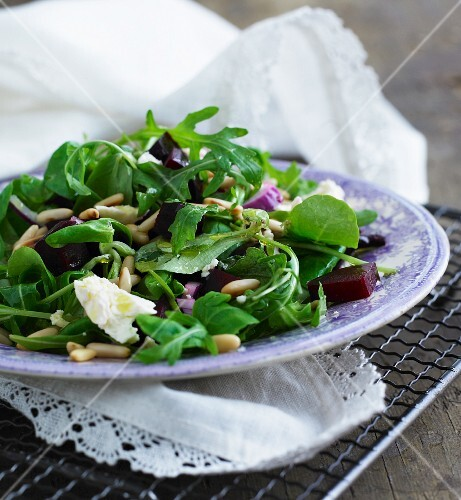 A mixed leaf salad with beetroot, pine nuts and goat's cheese
