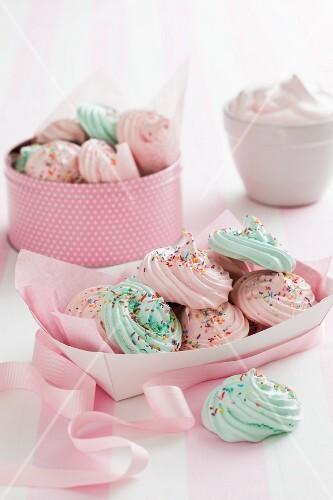 Pastel coloured meringues with sugar sprinkles
