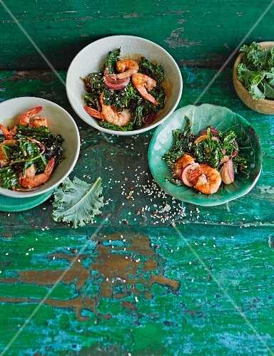 Spicy garlic prawns with chilli flakes, orange zest and green kale