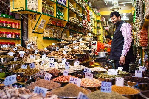 A street vendor in his spice shop in Delhi, India