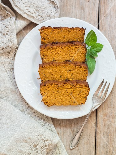 Homemade vegan chickpea cake with basil leaves