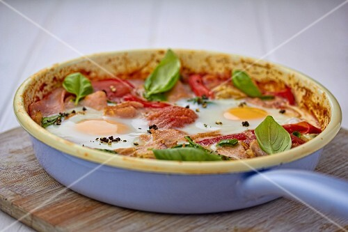 Colourful fried breakfast with ham and fried eggs