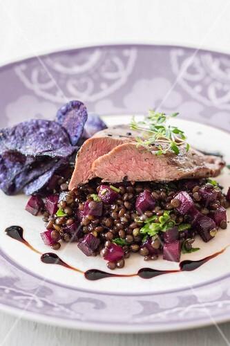 Lamb fillet on a lentil salad