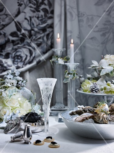 A Christmas table laden with oysters, caviar and champagne
