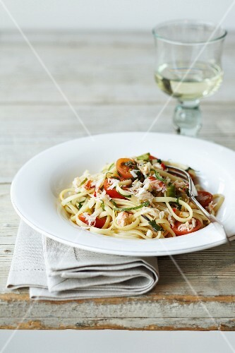 Linguine with crab, tomatoes, courgette and grated cheese