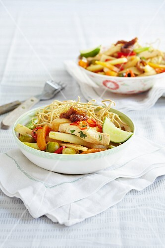 Crispy egg noodles with turkey, carrots, Brussels sprouts, chillis and limes