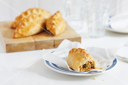 Puff pastry pasties filled with curried fish