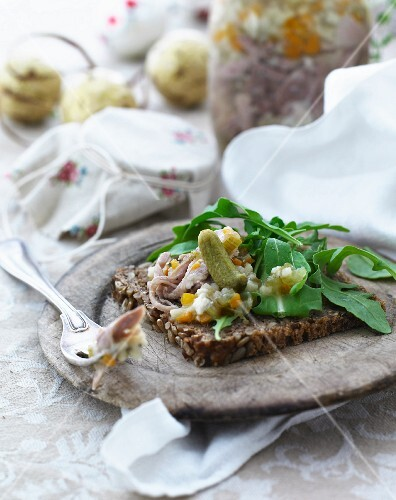 Wholemeal bread topped with pickled fish and gherkins