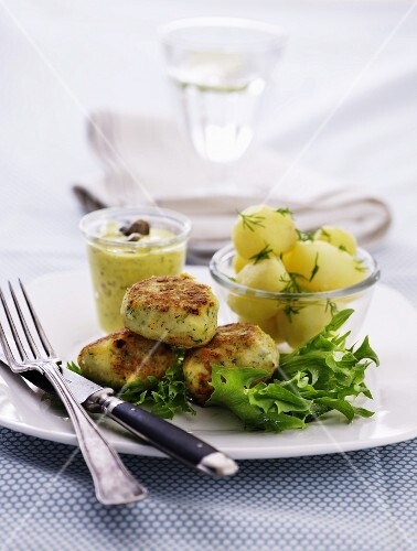 Fish cakes with mini boiled potatoes and homemade remoulade