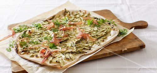 Tarte flambée with green asparagus and raw ham