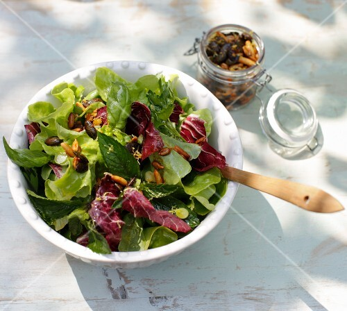 A mixed leaf salad with fresh herbs and roasted seeds