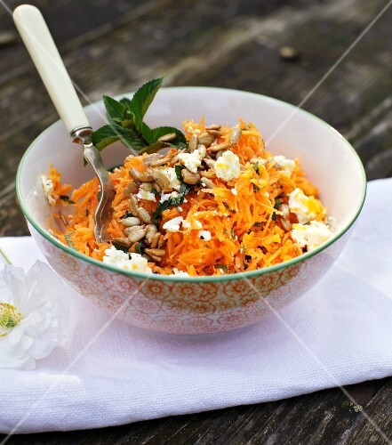Carrot salad with sunflower seeds and sheep's cheese