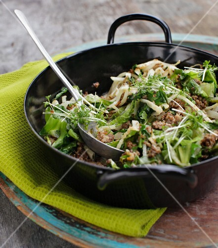Black winter radish with minced meat and garden cress