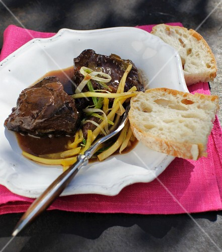 Veal cheeks braised in red wine with julienned vegetables