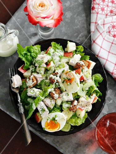 Caesar salad with hard-boiled eggs and croutons