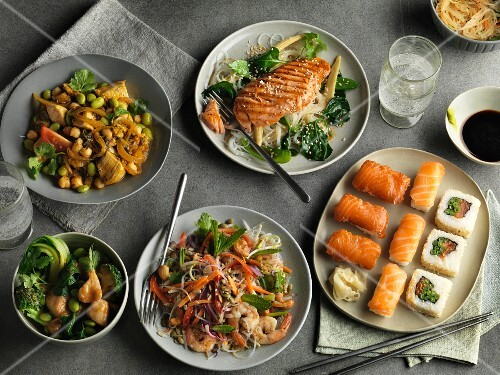 An arrangement of five different oriental dishes