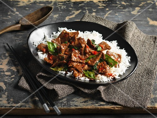 Spicy beef with Thai basil on a bed of rice (Thailand)