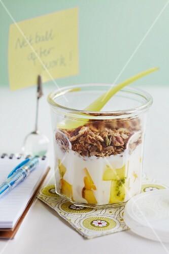 Yoghurt with mango and crunchy nut muesli
