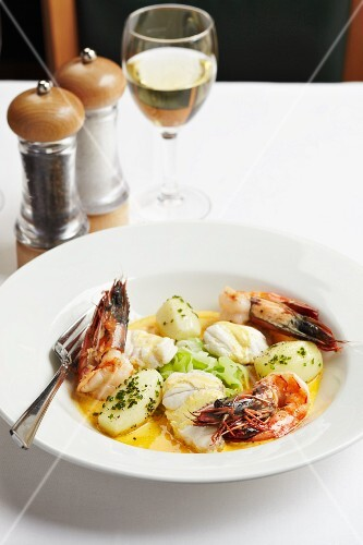 King prawns with fish, potatoes and chives