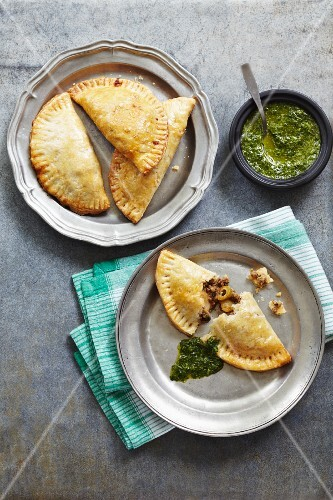 Lamb and olive pasties with spinach pesto