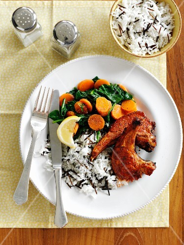 Lamb chops with harissa served with rice and fried vegetables