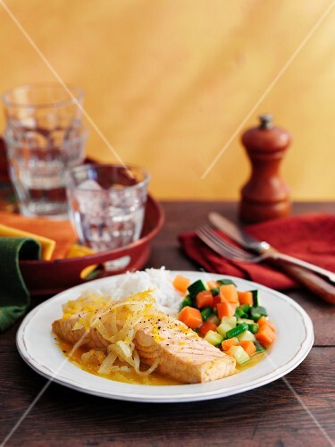 Salmon in an orange sauce with vegetables and rice