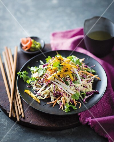 Sushi and vegetable salad with crab meat and peaches