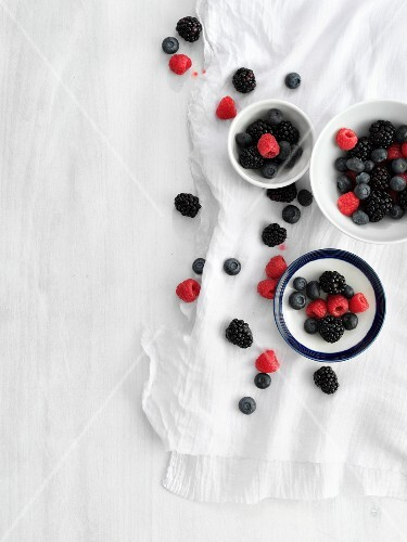 Bowls of fresh summer berries (seen from above)