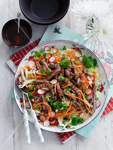 Beef salad with carrots and radishes (Thailand)