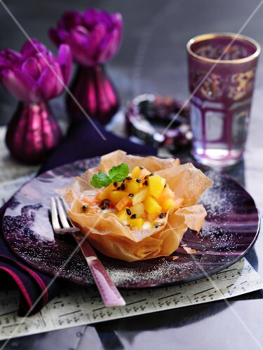 Exotic fruit salad in a filo pastry bowl