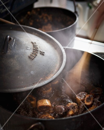 Ossobucco being braised in a pot