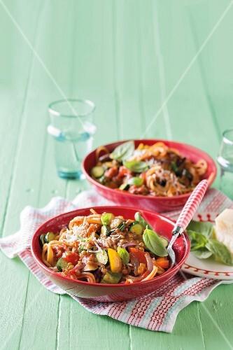 Pasta with lentil ratatouille and fresh basil