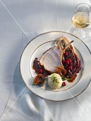 Rack of pork with radicchio, figs and cranberries