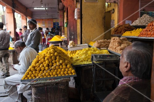 A street vendor selling a variety of sweets in Jaipur, India