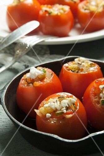 Stuffed tomatoes with courgette and feta cheese
